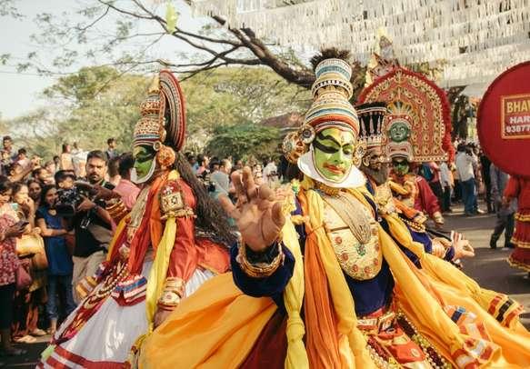Enjoy a mesmerizing Kathakali performance in Kerala.