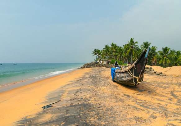 Fishing Boat on Tropical beach in Kovalam
