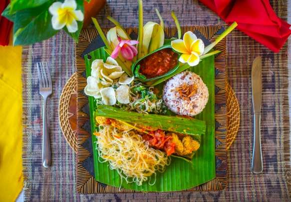 Savor a traditional Indonesian dish in Bali on this honeymoon holiday.