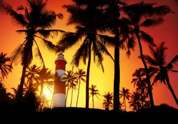 Visit the Lighthouse Beach in Kovalam during sunset with your partner.