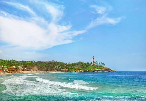 Visit the Kerala province beach with a vivid lighthouse.
