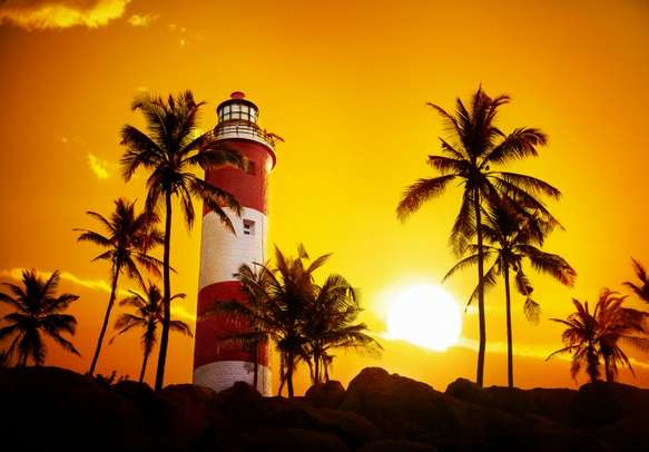 Stroll around the Lighthouse beach on this Kerala holiday tour.