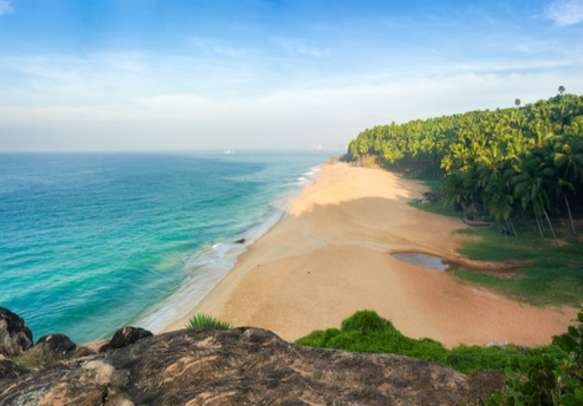 Enjoy a day at the Kovalam beach on this Kerala holiday tour.