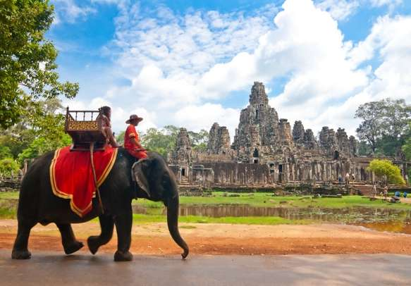 Watch elephants in action at Bayon temple in Cambodia.