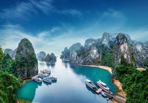 Tourists enjoying Halong Bay cruise