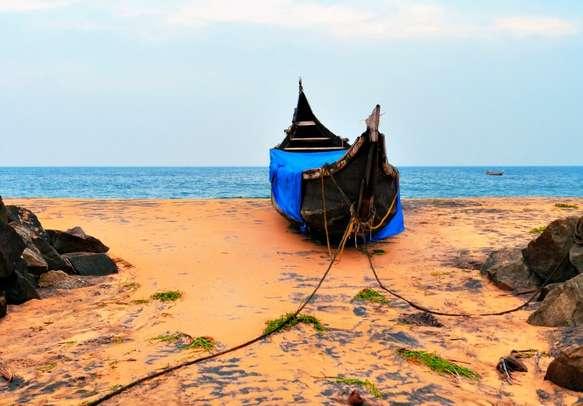 A fishing boat at the beautiful Kovalam Beach