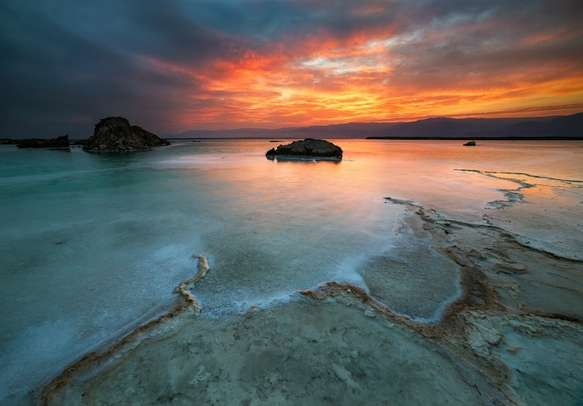 A surreal view of sunrise from the shore of Dead Sea