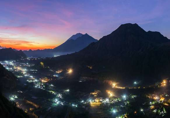 Sunrise over the caldera of Batur volcano in Bali