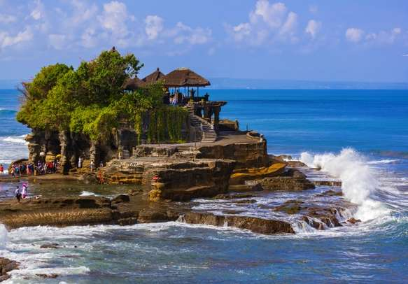 Visit the picturesque Tanah Lot Temple in Bali