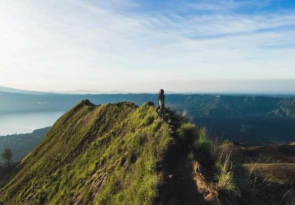Beautiful woman at the top of Mount Batur Bali