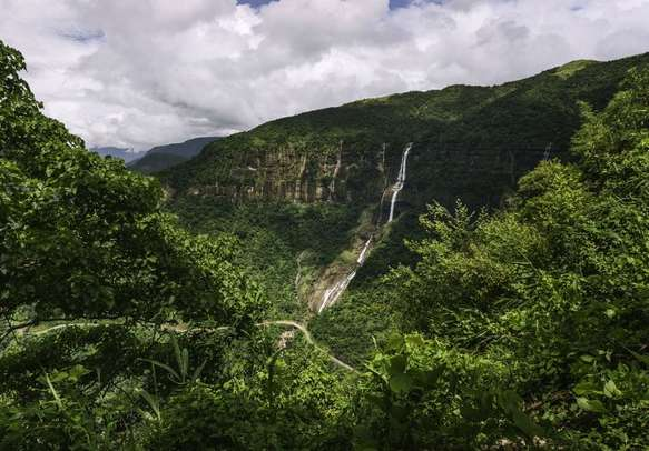A distant view of a gorgeous waterfall in Shillong