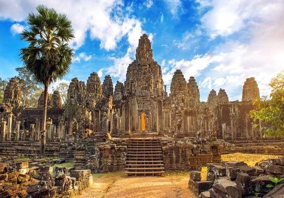 Ancient stone faces at sunset of Bayon temple, Angkor Wat