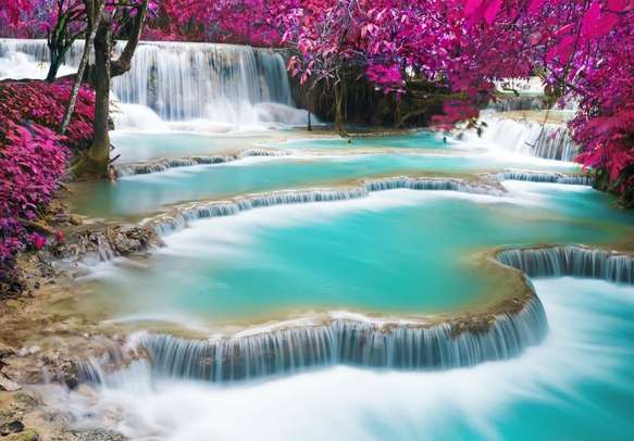 Witness the mesmerizing beauty of the waterfall in Luang Prabang
