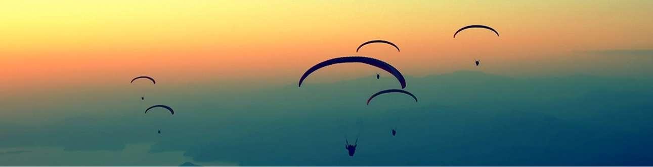 Enjoy the bird's-eye view while paragliding in Munnar
