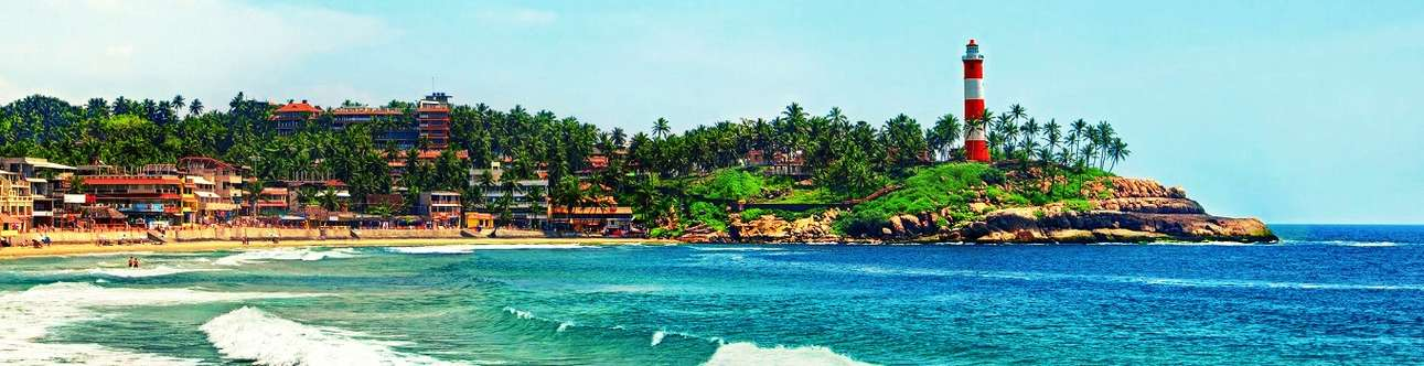 Walk along the smooth sand beaches in Kovalam