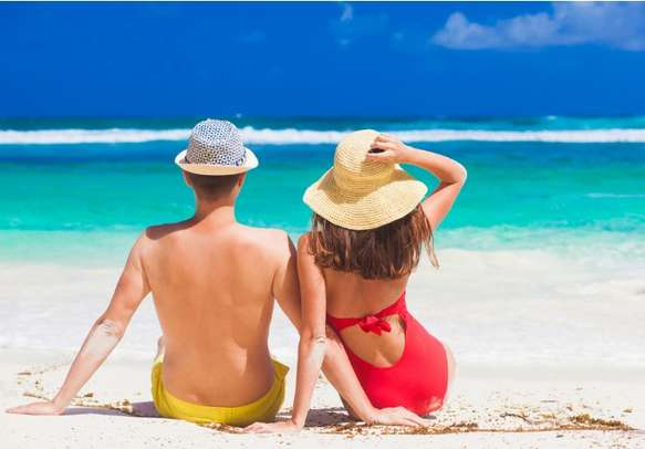 A couple relaxing at a beach in Mahe Island