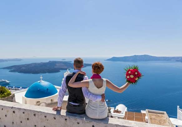 A couple having a great time in Santorini