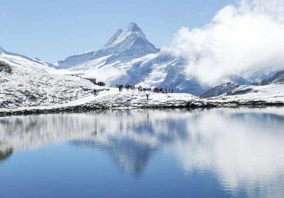 Watch lovely snow capped Swiss Alps in Interlaken