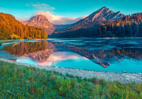 Delight in colorful summer sunrise on the incredibly beautiful lake