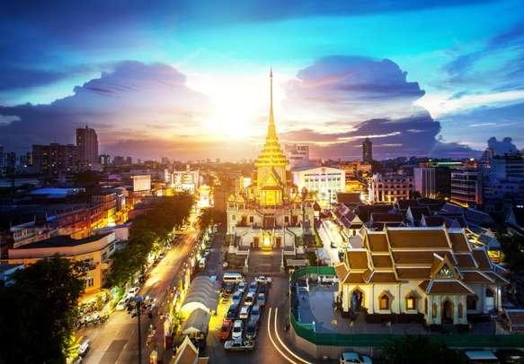 Glorious sunset at Wat Traimit in Bangkok