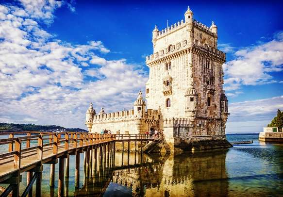 Visit the Tower of Belem on an island in the river Tagus in Lisbon, Portugal