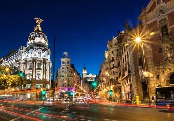 Enjoy at Gran via street in Madrid, Spain