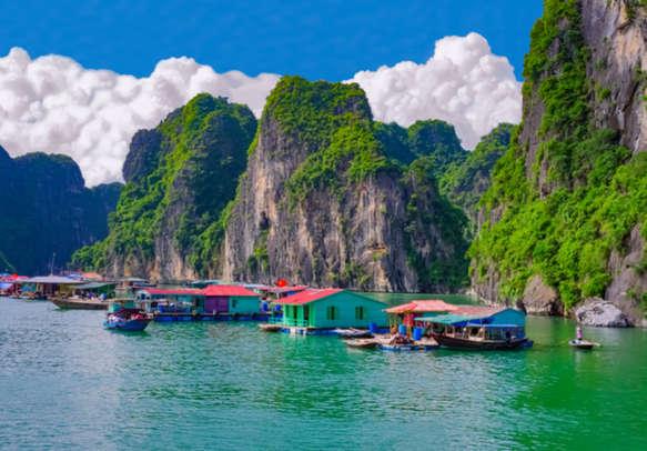 Floating fishing village near rock islands in Halong Bay, Vietnam