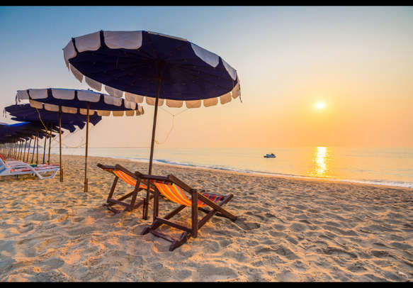 Relax under the shade of a beach umbrella in Thailand