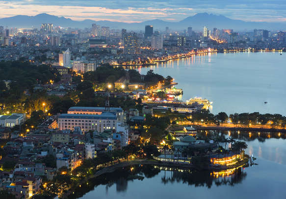 Drink in the charm of Hanoi cityscape at twilight