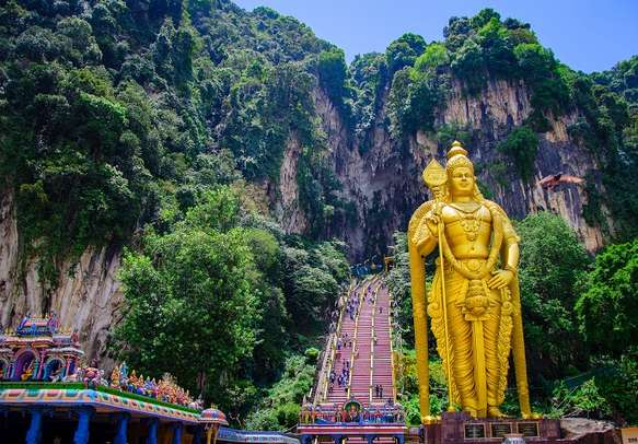 Witness the Golden Statue of Lord Muruga on your Kuala Lumpur tour