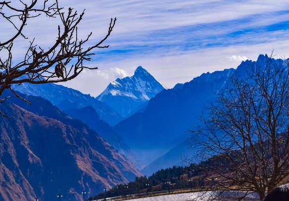 Glistening mountain peaks Of Himalayas