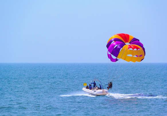 Enjoy parasailing in Goa