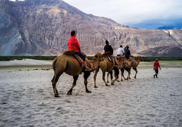 Tourists enjoy horse riding to Pahalgam valley