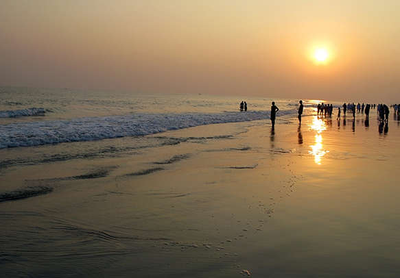 Delight in an amazing sunset at a beach in Puri