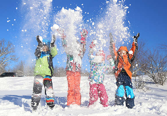 Group of children playing with ice and enjoying the weather