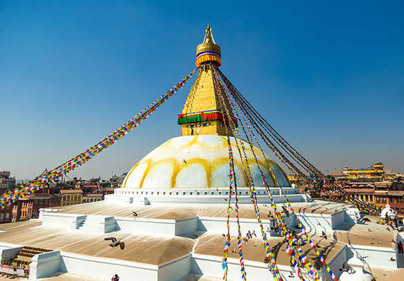 Visit the famous Swayambhunath Temple adorned with colorful prayer flags