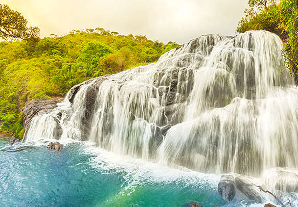 Admire the mesmerising view of the waterfall