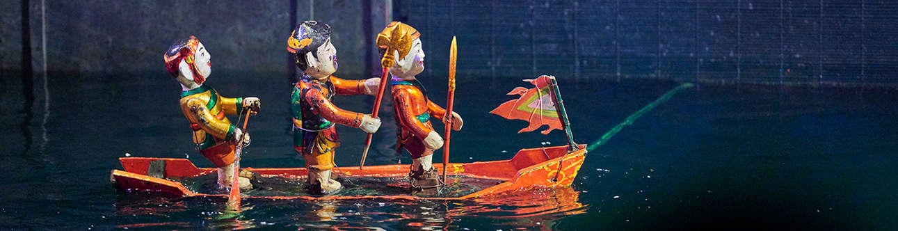 Watching Water Puppet Show In Hanoi