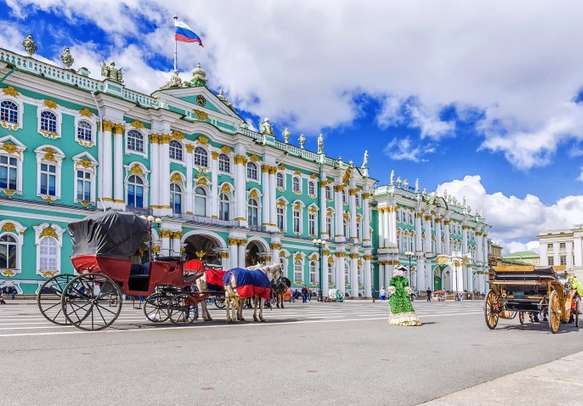 Horse drawn carriages on the Palace Square in St. Petersburg