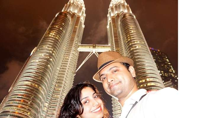 Bhargav and his wife click a selfie near Petronas Towers Malaysia