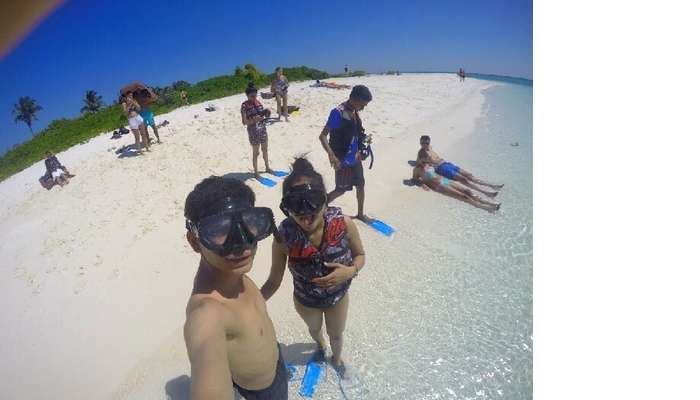 Nisarg and his wife on a beach in Maldives