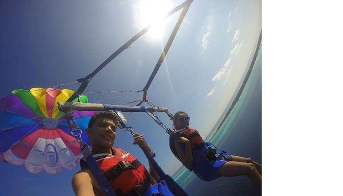 Nisarg and his wife parasailing in Maldives
