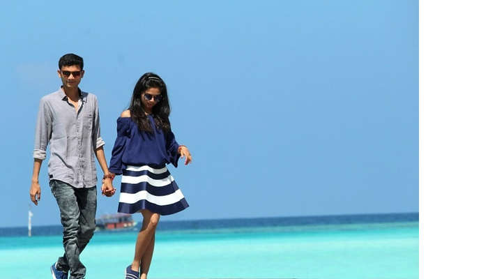 Nisarg and his wife pose for a picture in Maldives