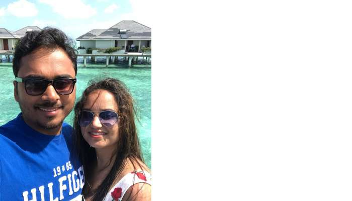 nihal and his wife at the water villa at sun island