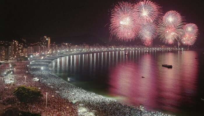 An illuminated party beach during Hawaii New Year celebrations
