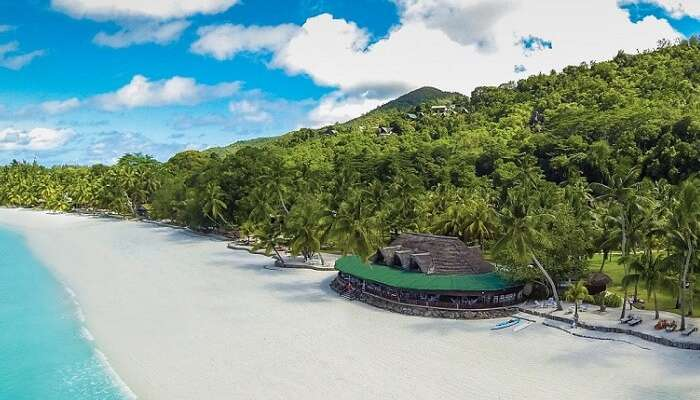 The beach and the beach restaurant at Paradise Sun Resort in Seychelles