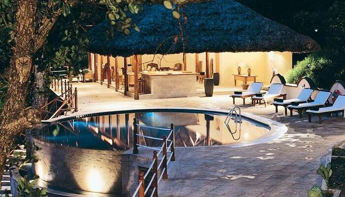 A night shot of the pool at Cerf Island Resort
