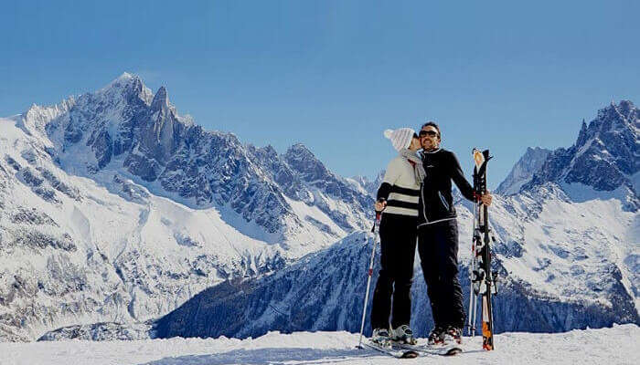 A couple enjoys their visit to the Chamonix ski resort