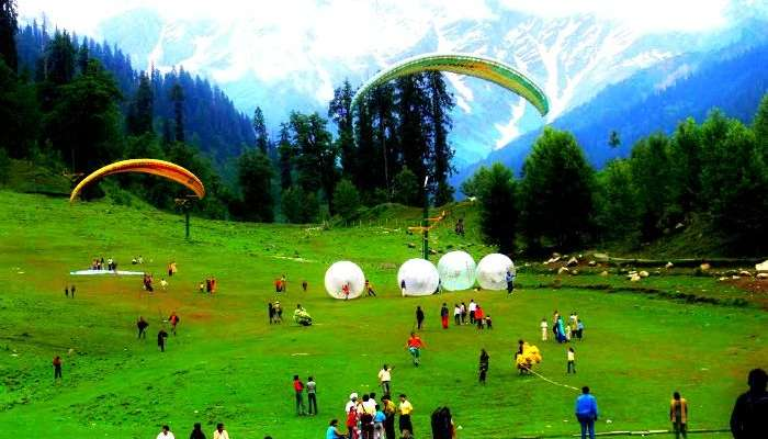 Breathe the fresh Himalayan breeze by paragliding & mountaineering in Manali