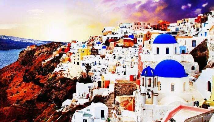 Yunanistan'da Santorini kıyısında gün batımı